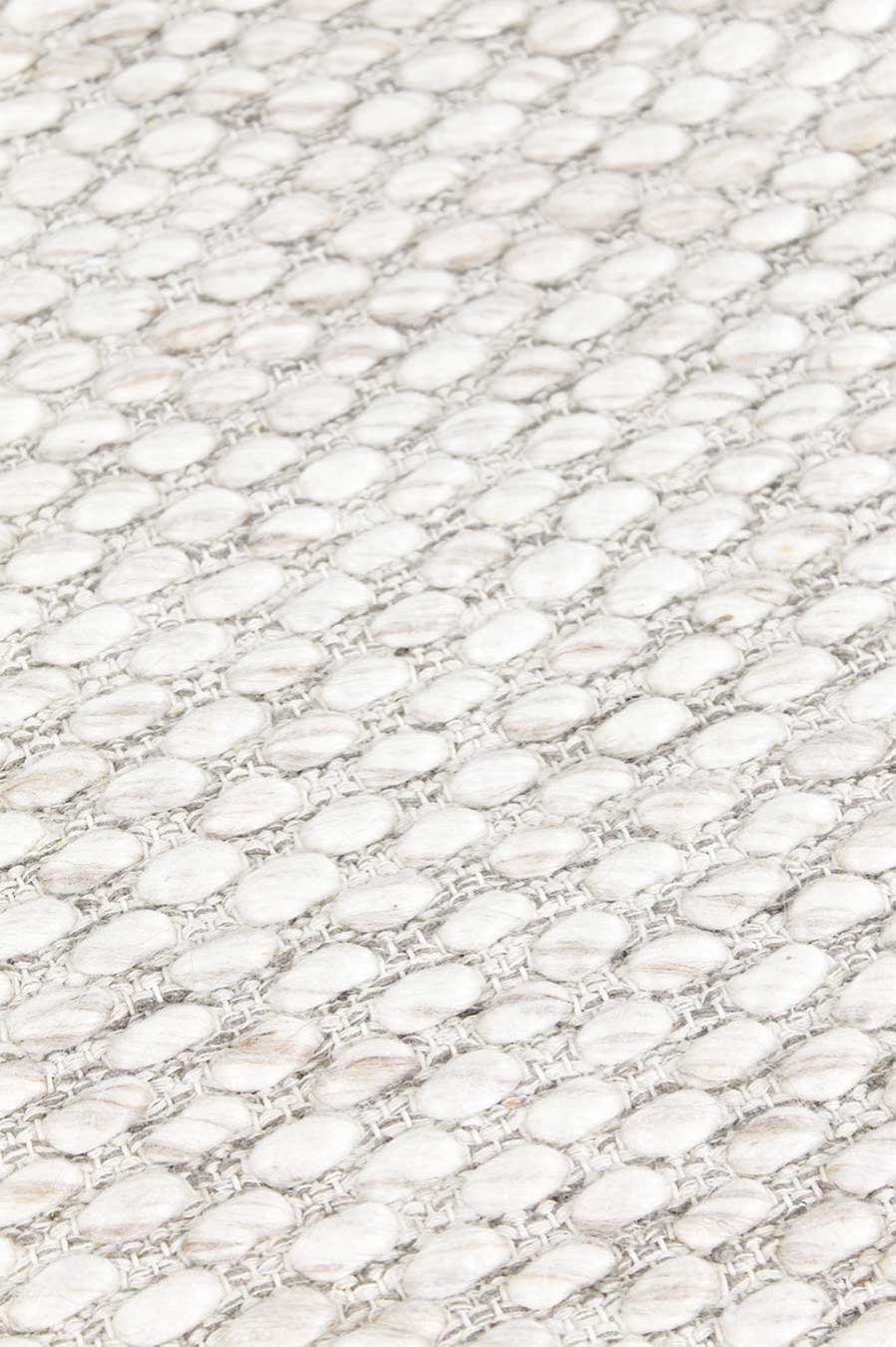 Detailed view of textured Cocos rug in ivory colour