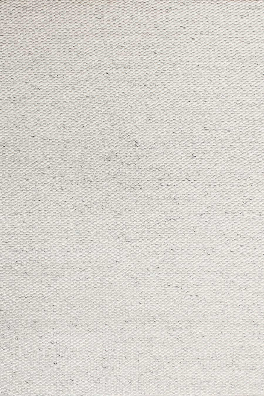 Overhead view of textured Cocos rug in ivory colour