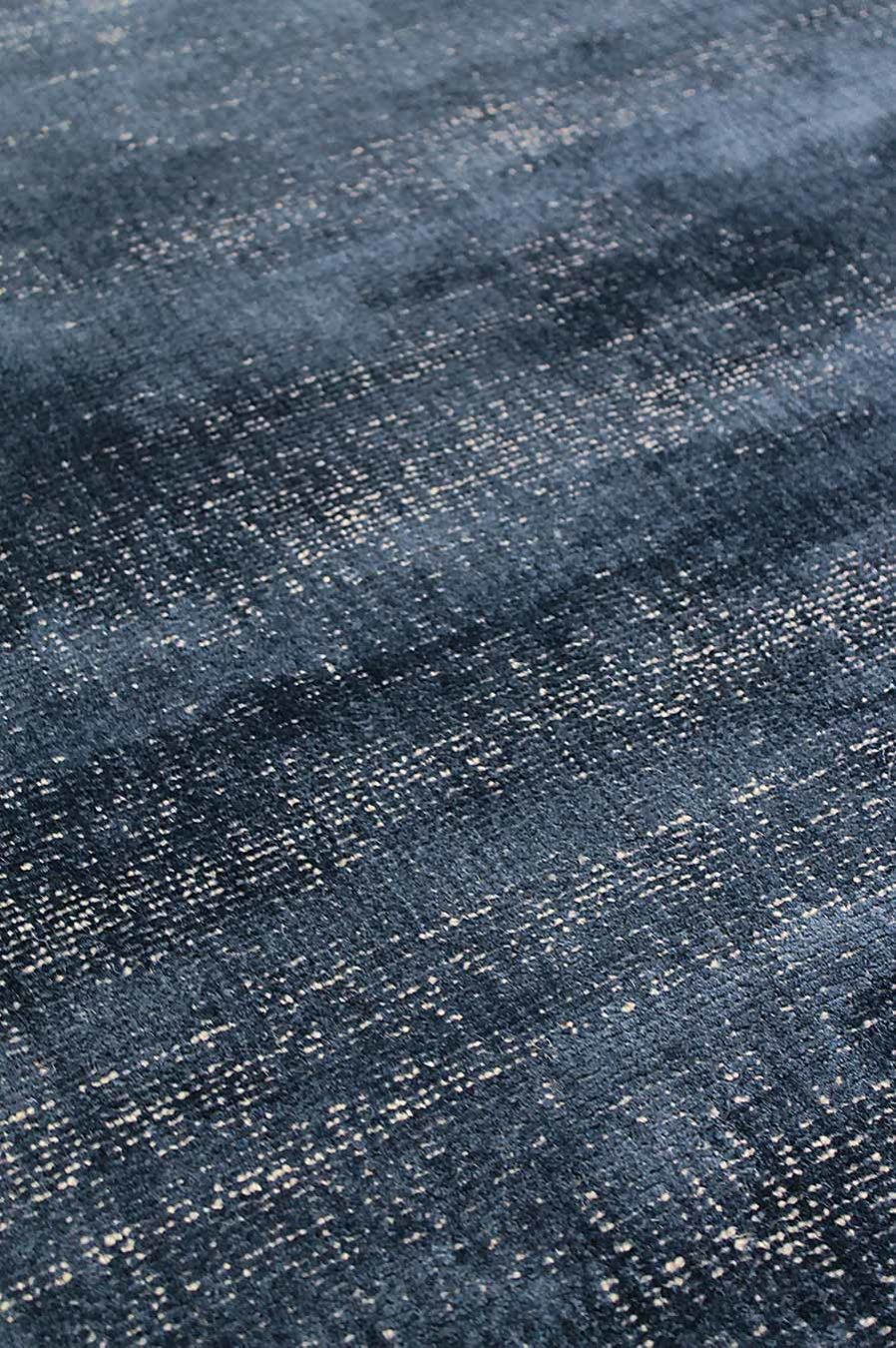 Close up view of textured Colorado rug in navy blue colour