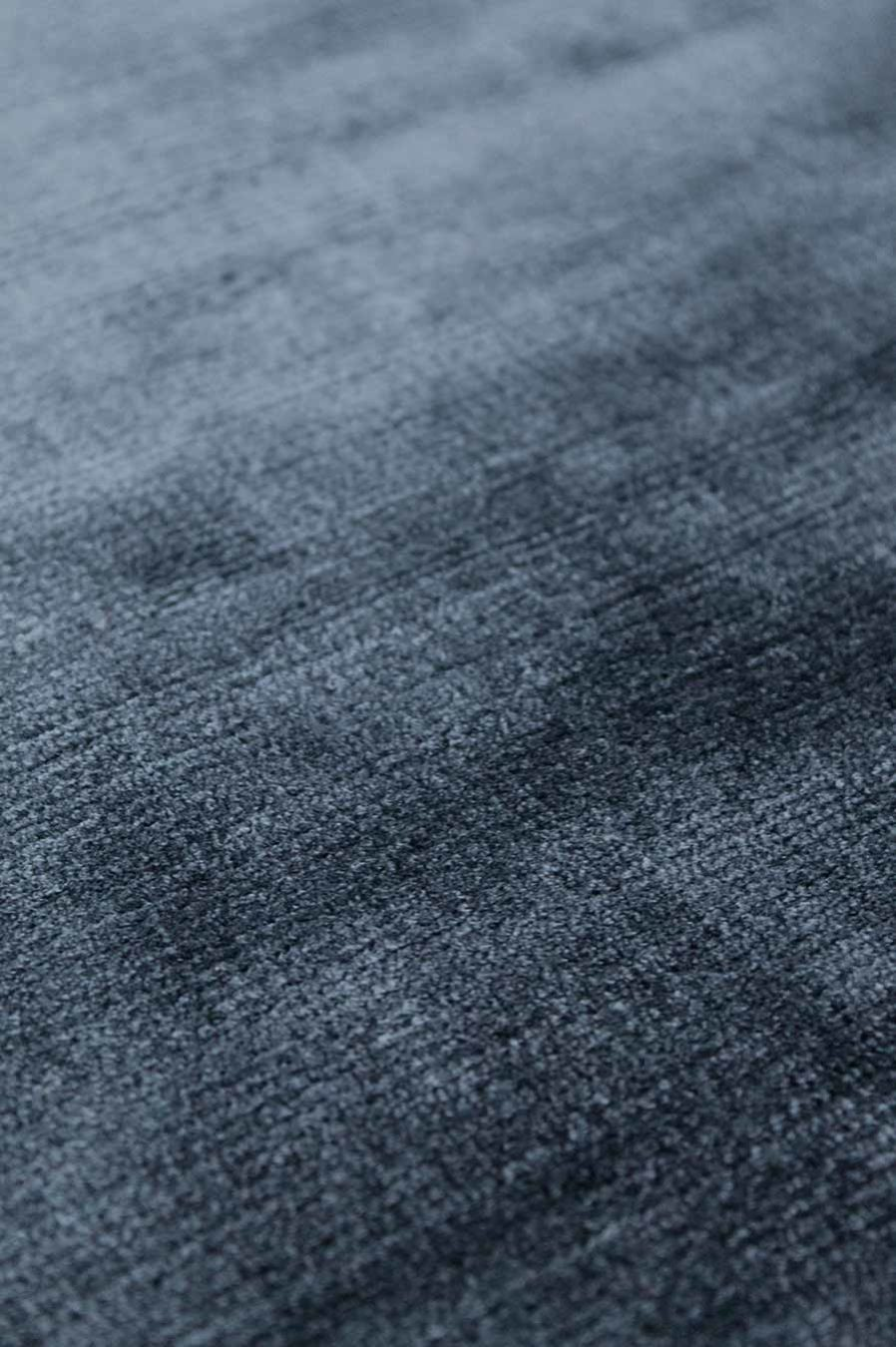 Detailed view of metallic Glam rug in navy blue colour