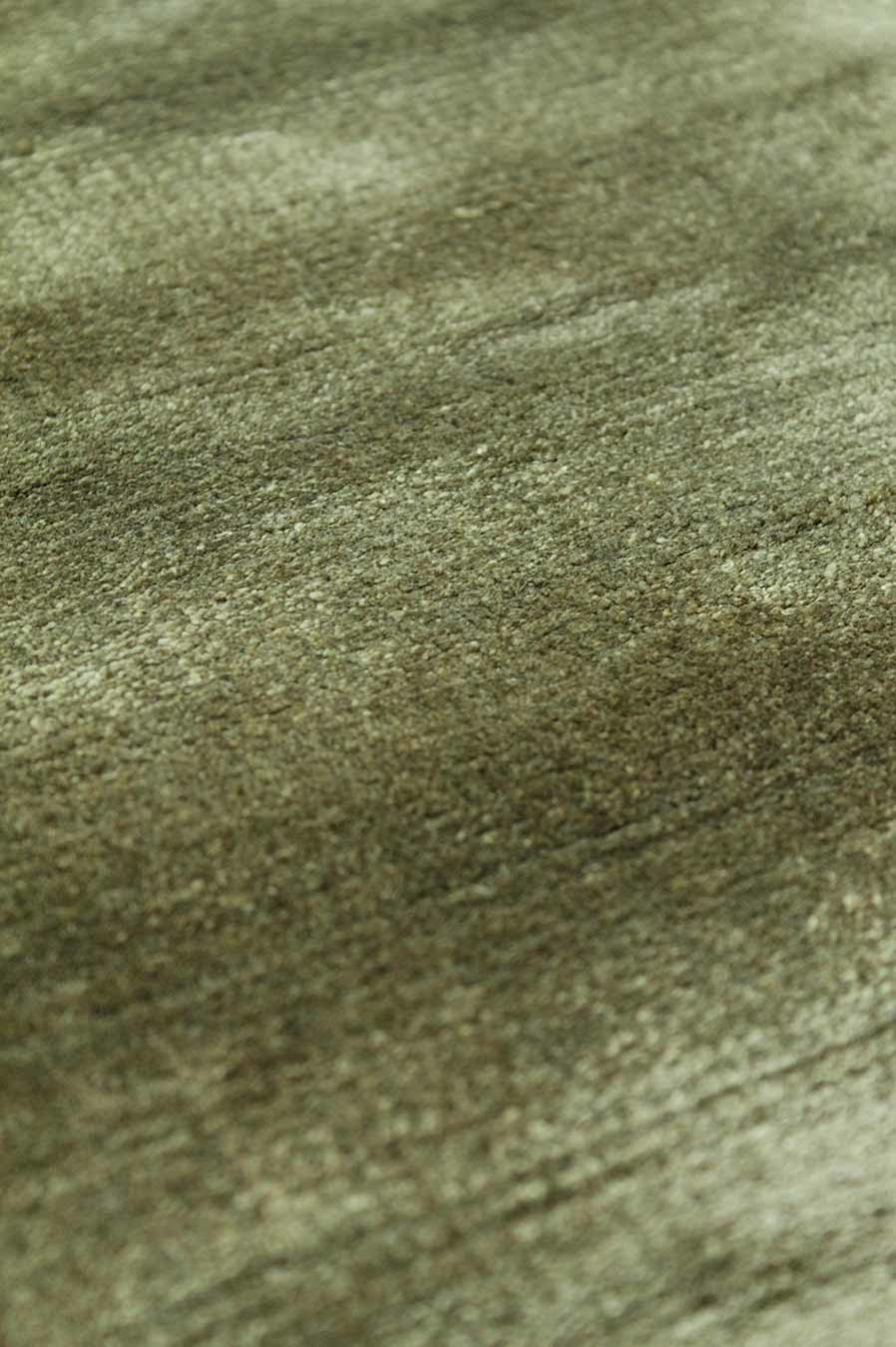 Detailed view of metallic Glam rug in olive green colour