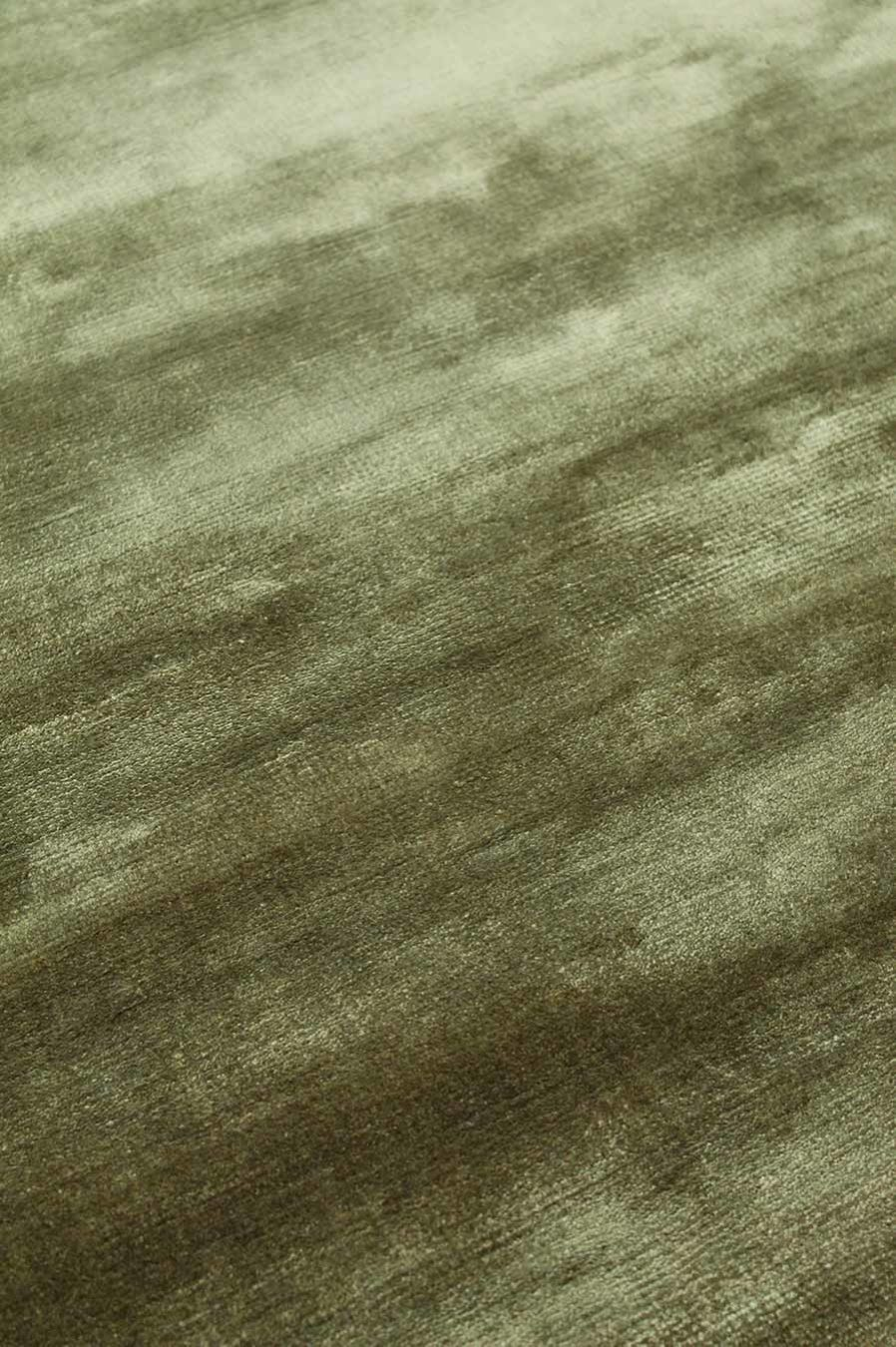 Close up view of metallic Glam rug in olive green colour