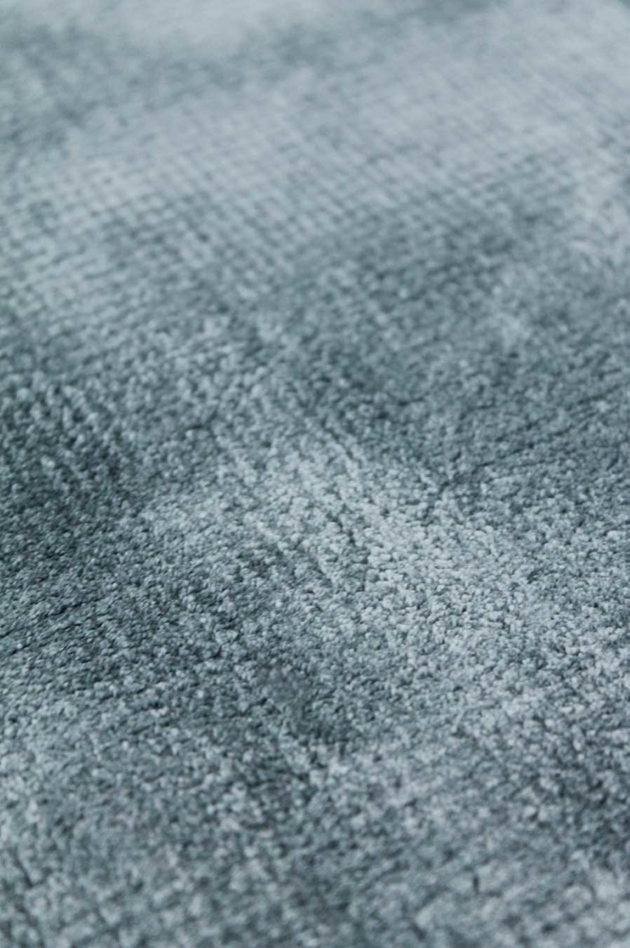 Detailed view of metallic Glam rug in teal colour