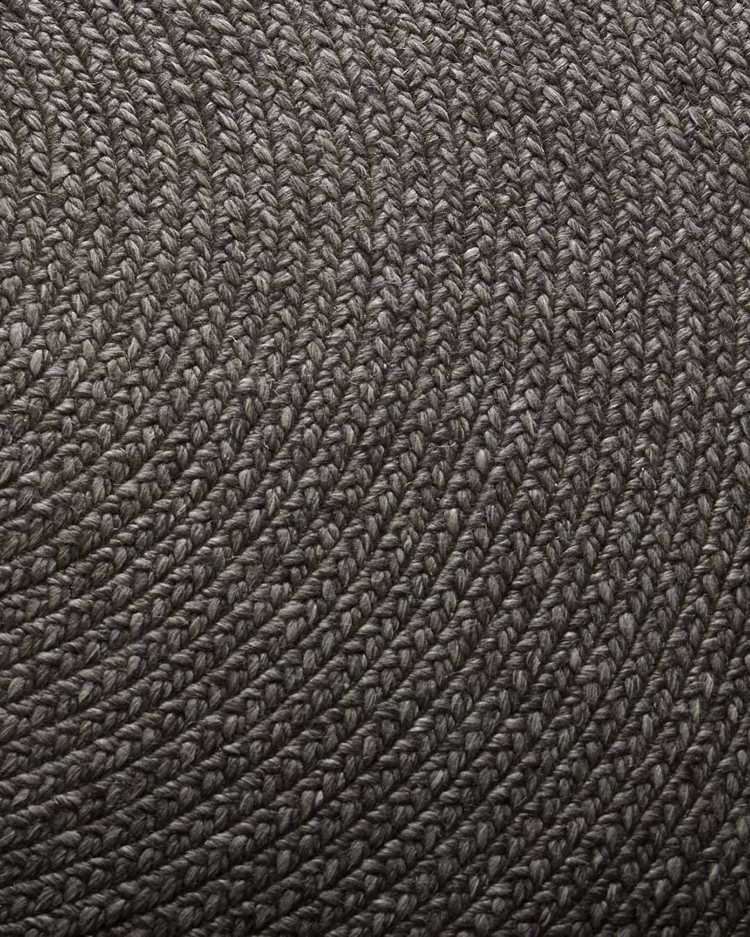 Close up view of Glenmore round rug in charcoal colour