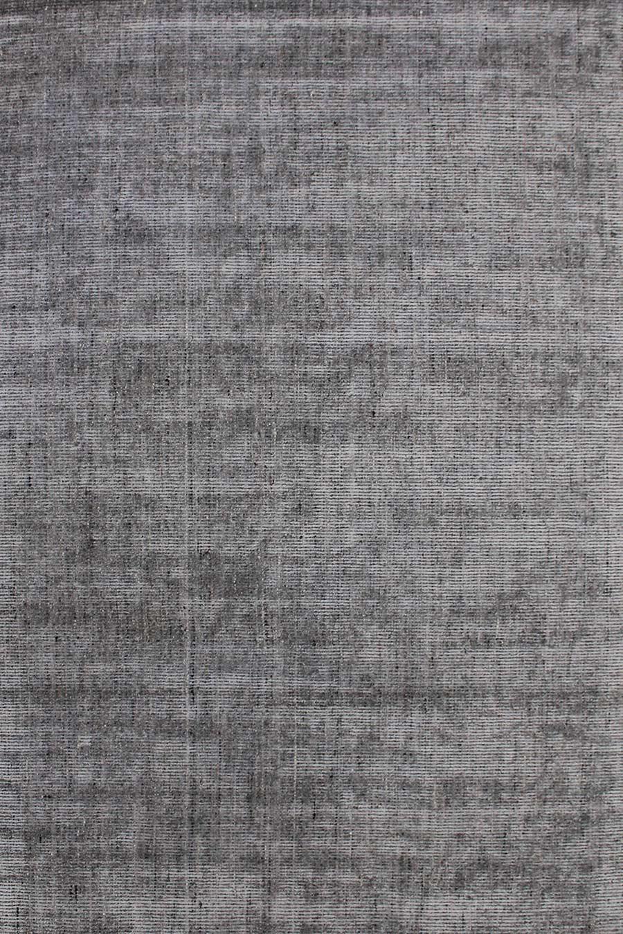 Overhead image of textured Gomez rug in dark grey colour