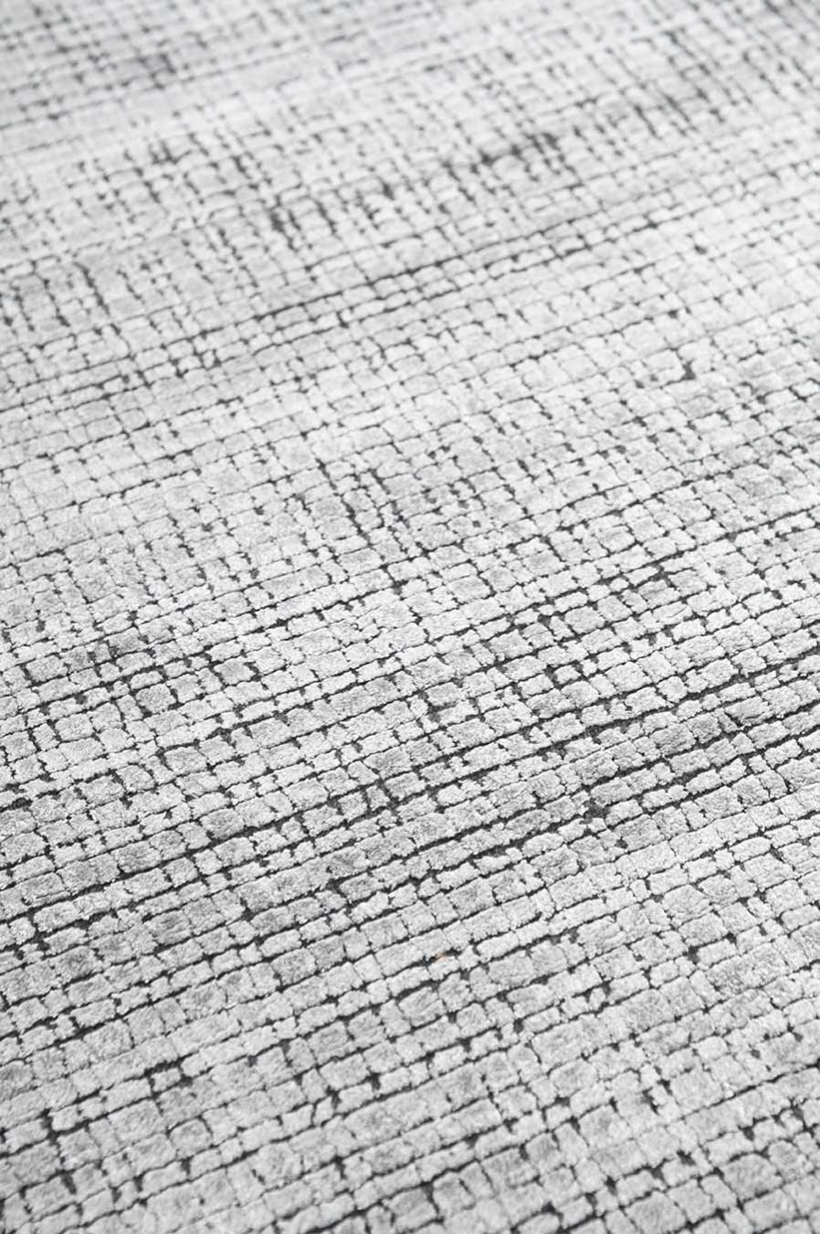 Detailed view of textured Molten rug in silver colour