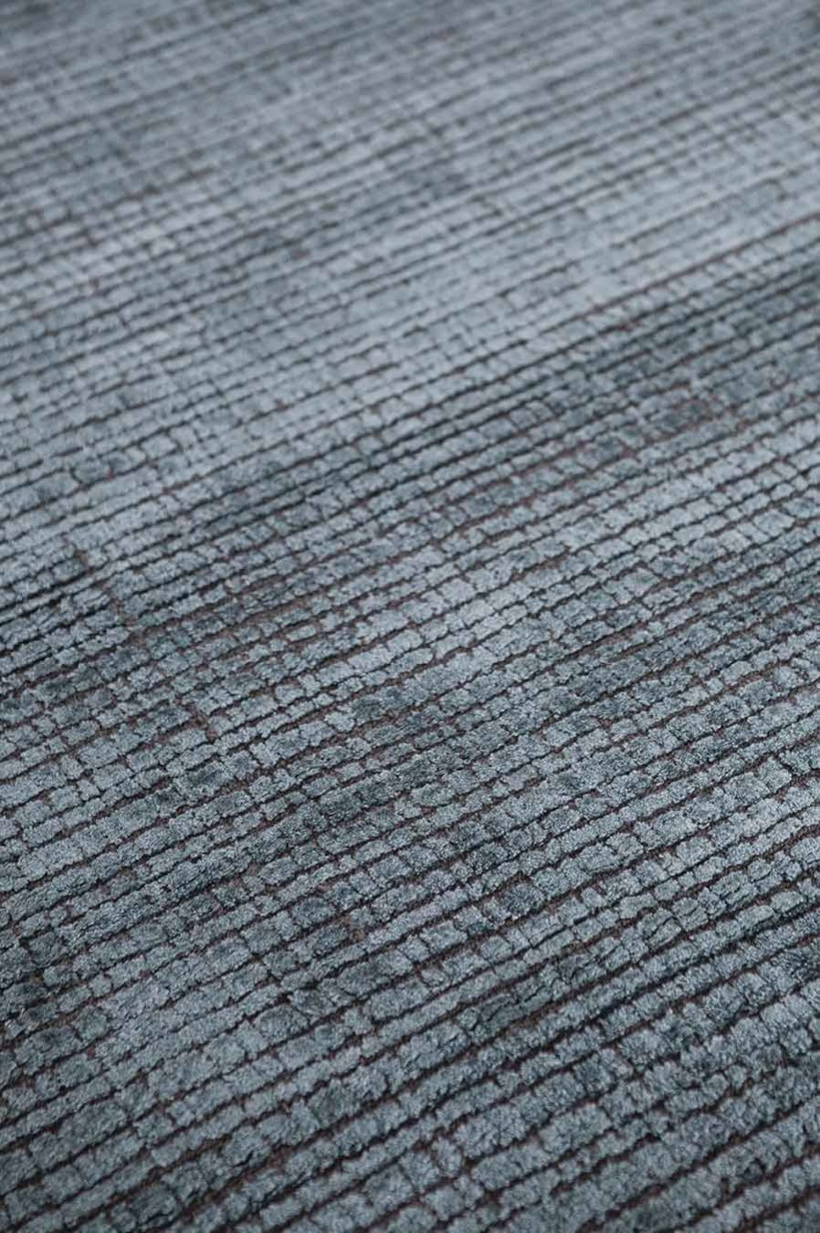 Detailed view of textured Molten rug in blue colour