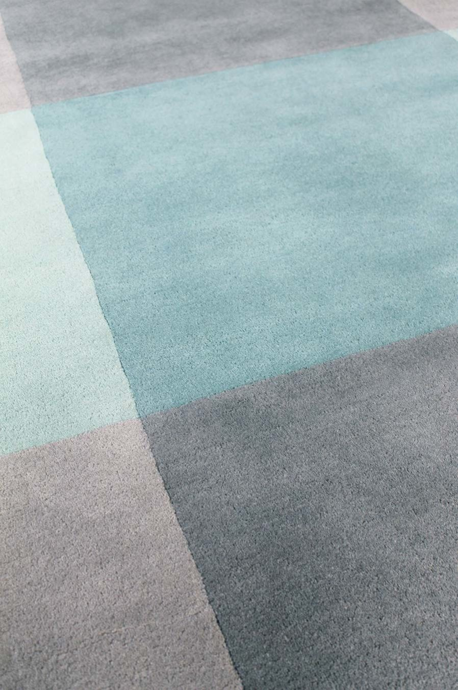 Detailed view of geometric Pitch rug in blue colour