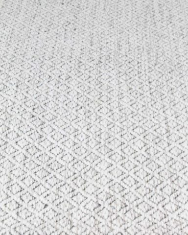 Detailed image of textured Plait Pastille rug in ivory colour
