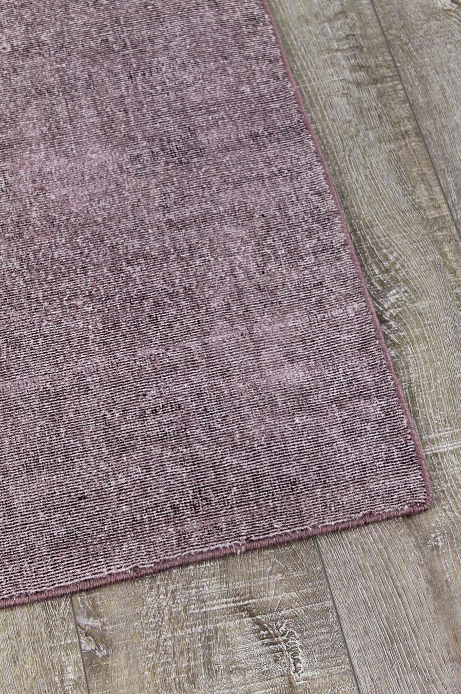 Detailed view of textured Rapture rug in purple colour