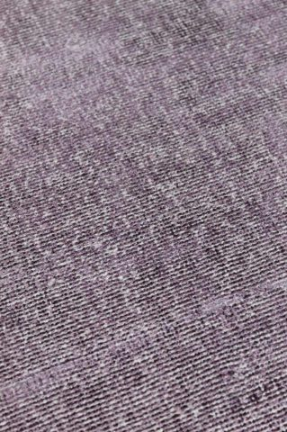 Close up view of textured Rapture rug in purple colour