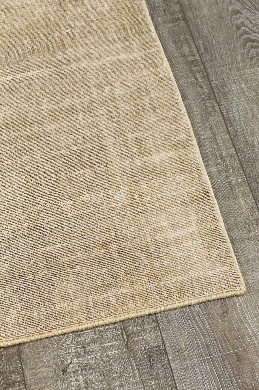 Detailed view of textured Rapture rug in mustard yellow colour
