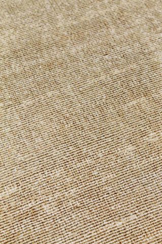 Close up view of textured Rapture rug in mustard yellow colour