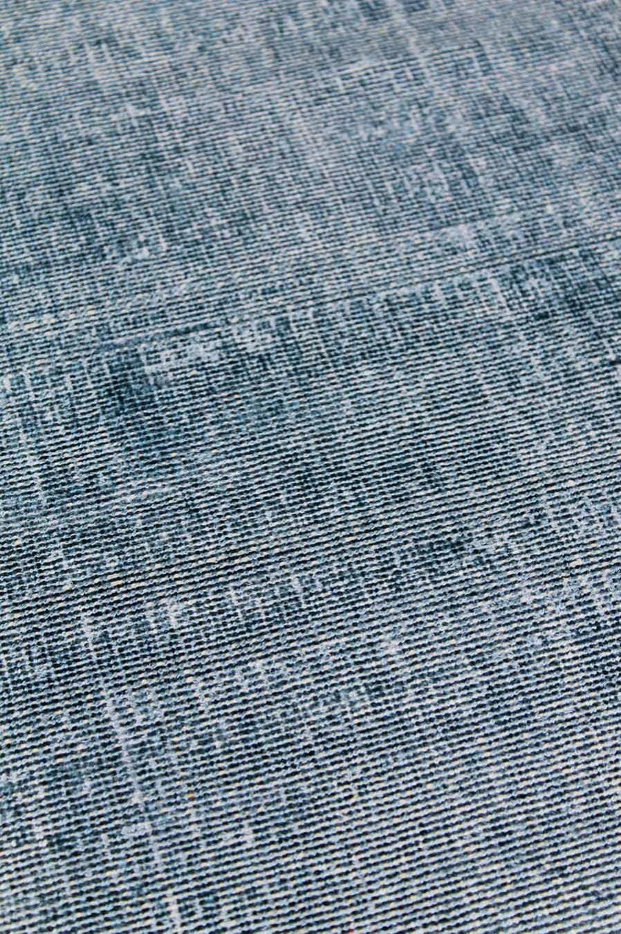 Close up view of textured Rapture rug in teal blue colour