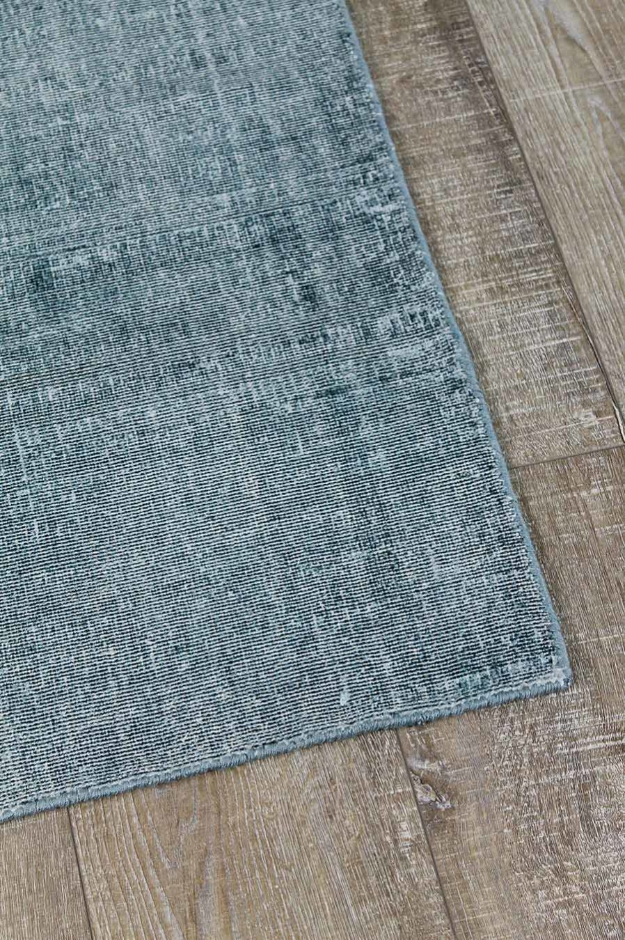 Detailed view of textured Rapture rug in teal blue colour