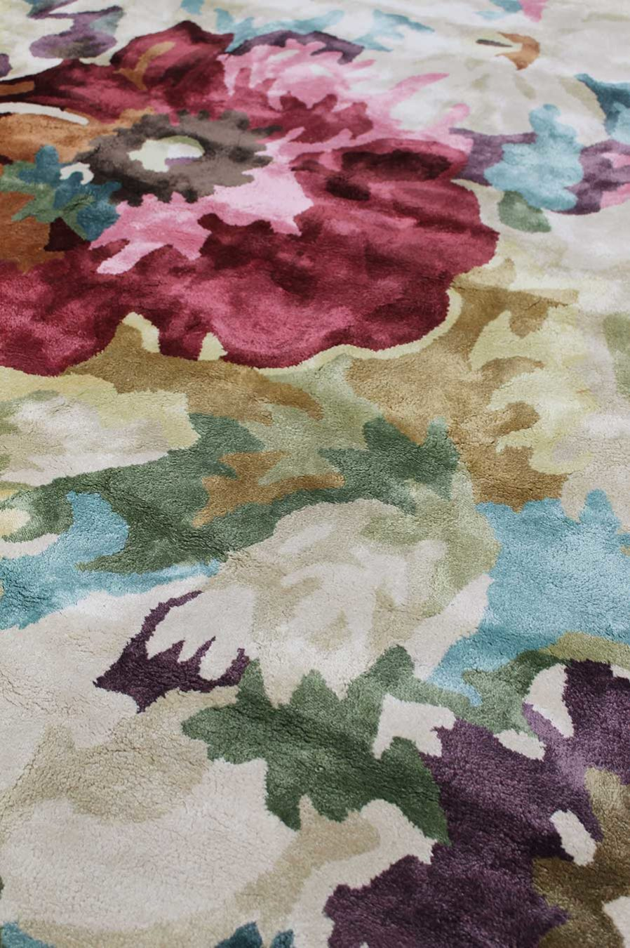 Close up view of floral multicoloured Rendezvous rug