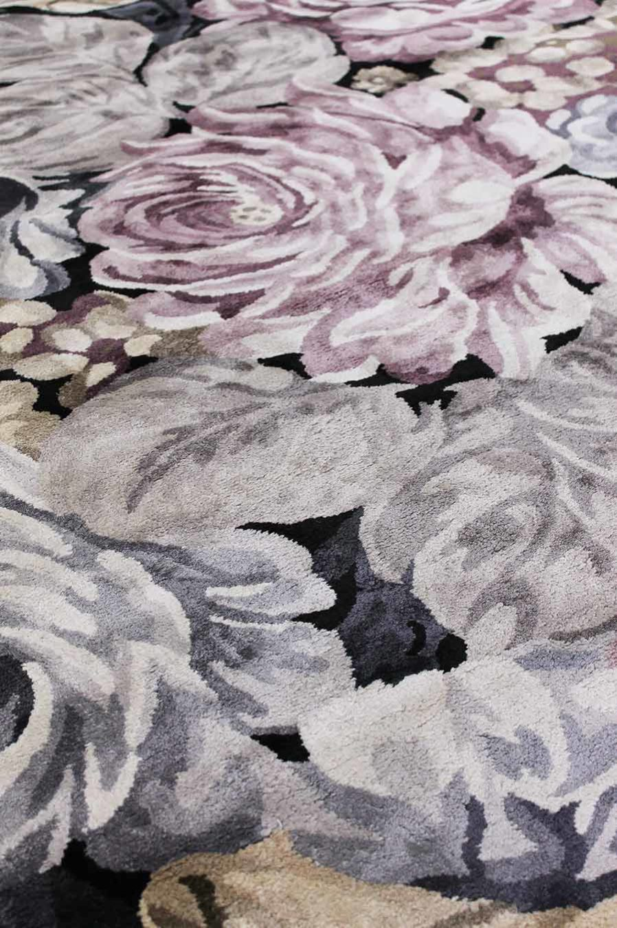 Close up view of floral Rendezvous rug in pink and purple colour