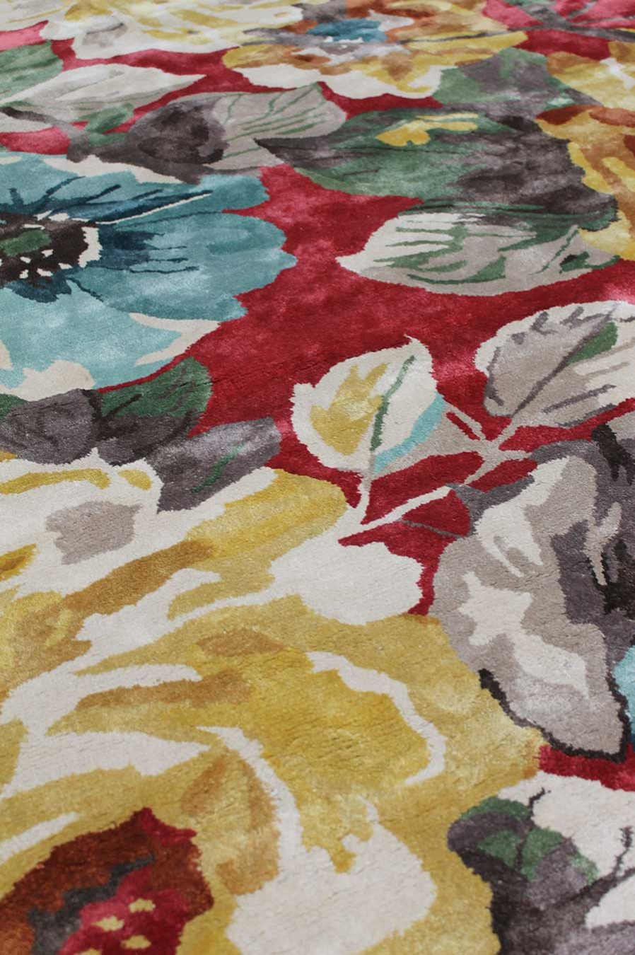 Close up view of floral Rendezvous rug in red and yellow colour