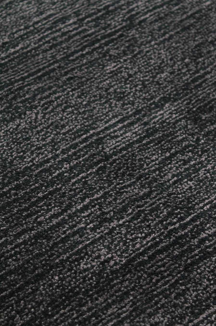 Close up view of circular Shroud rug in black colour