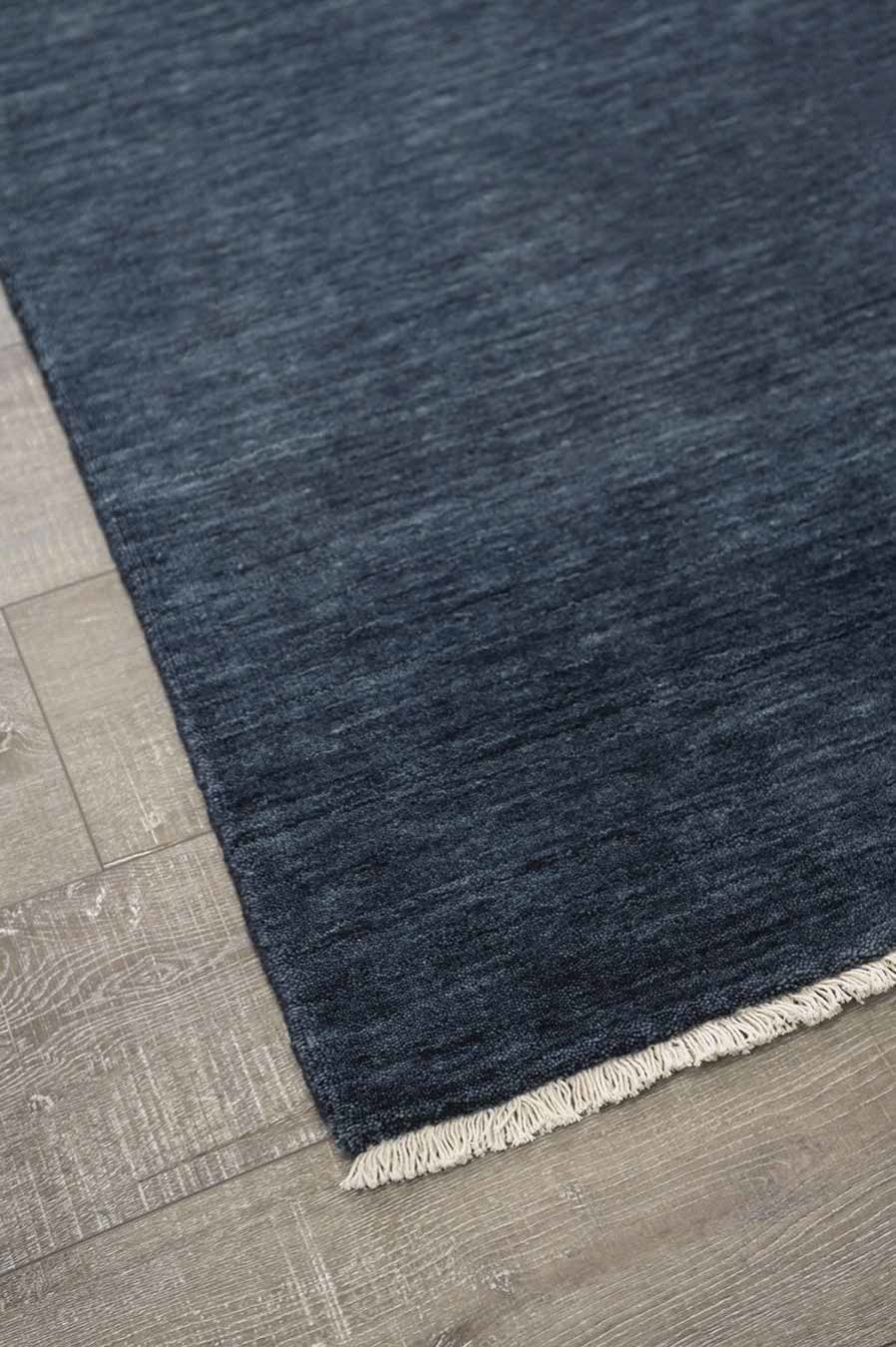 Detailed view of textured Zen rug in navy blue colour