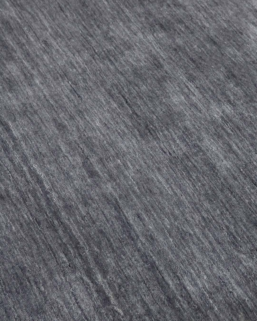 Close up view of textured Zen rug in grey colour