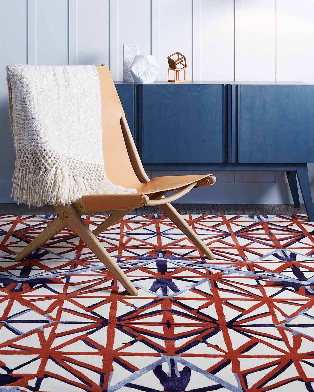 Living room setting of our modern, geometrically patterned Attic rug in charcoal