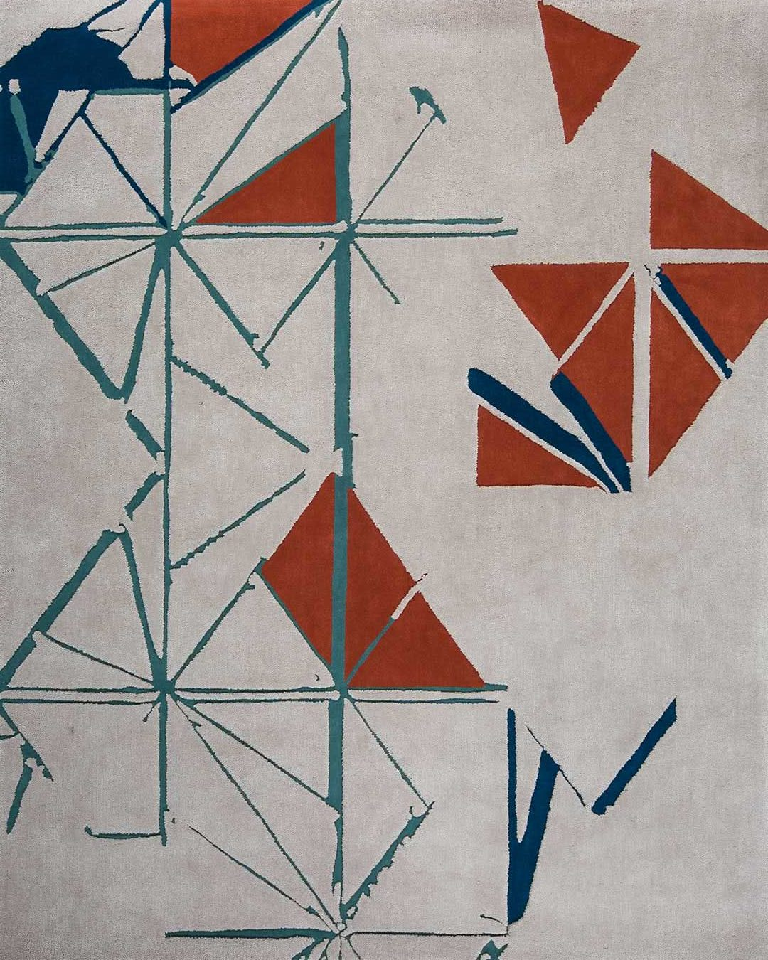 Detail view of our geometric and modern Despatch rug design in orange and teal