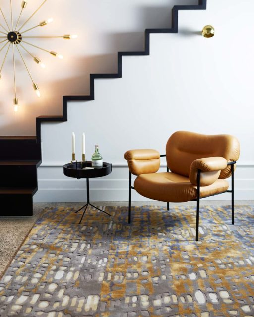 Room setting with our modern, textured Eden rug in brown and gold
