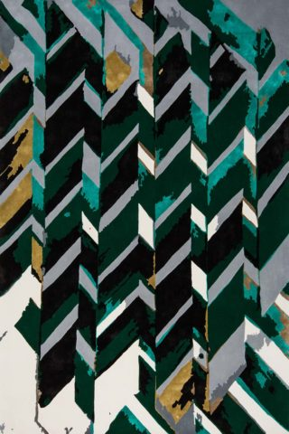 Overhead view of our modern, geometrically patterned Rift rug design in green