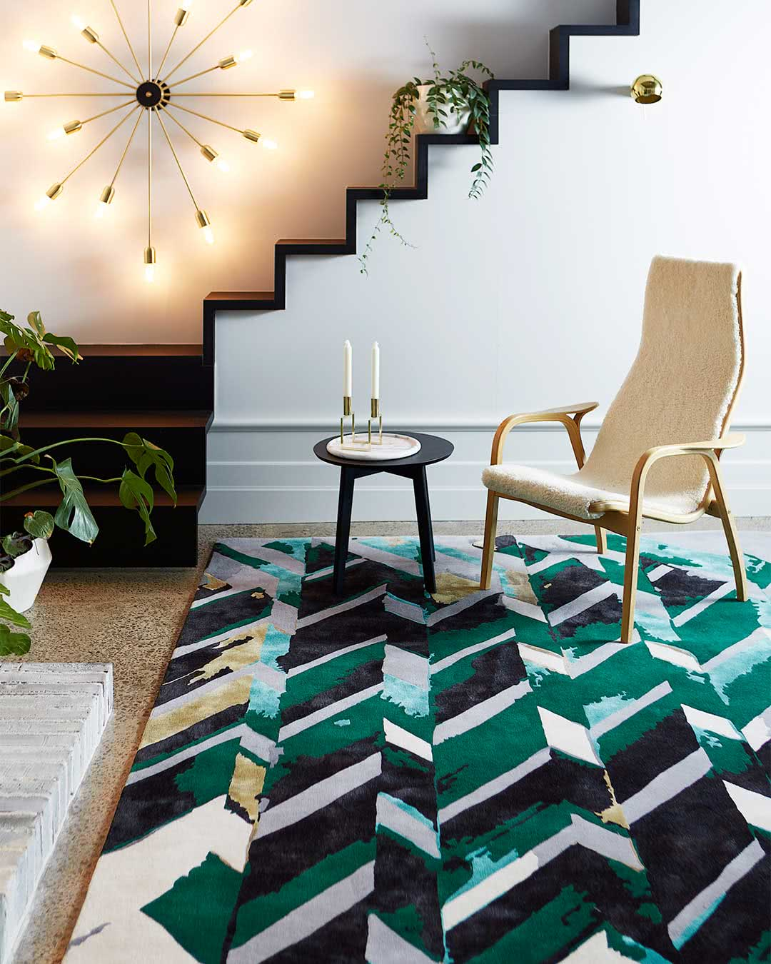 In room setting of our modern, geometrically patterned Rift rug design in green