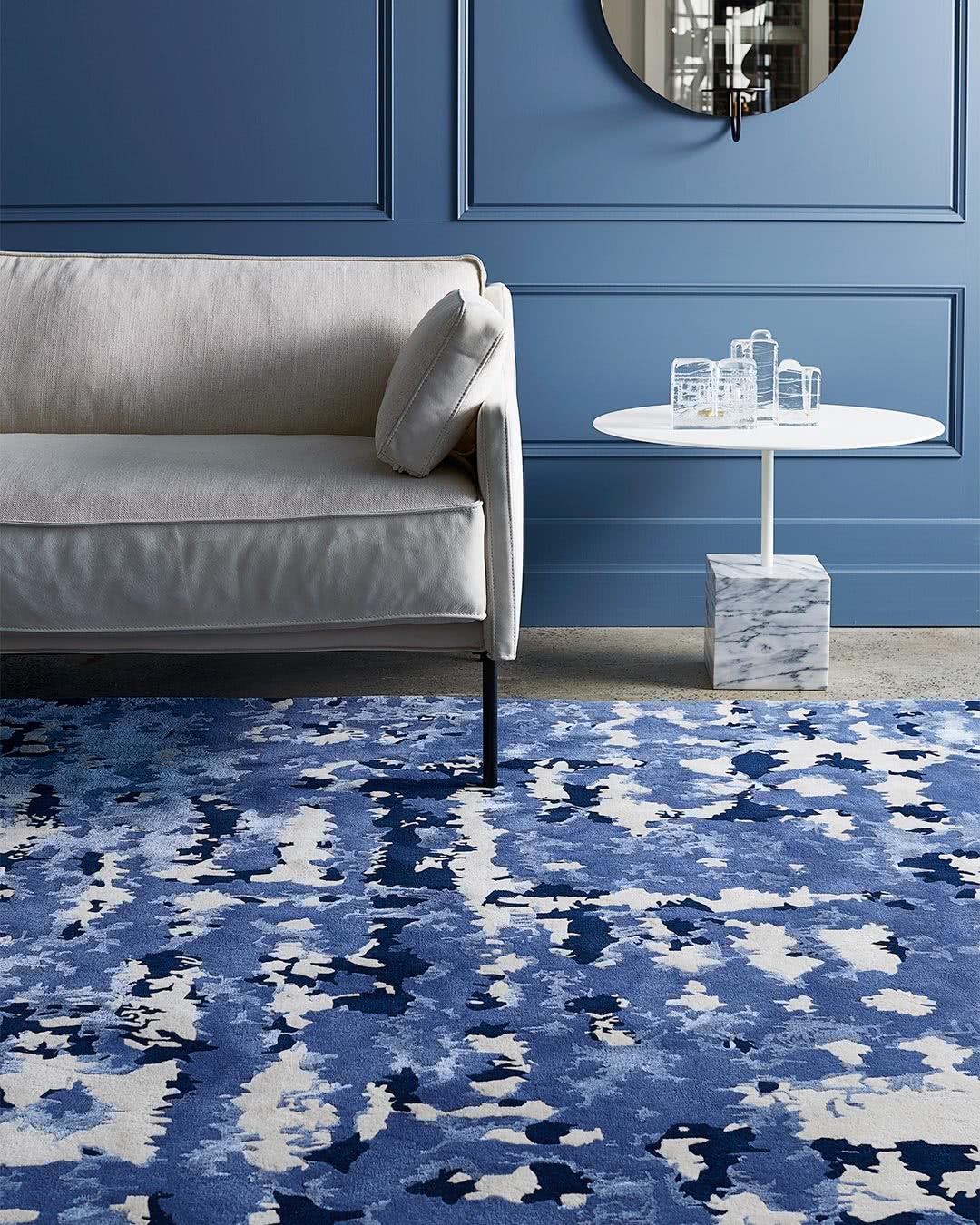 Styled setting featuring our modern, textured Zandt rug design in blue