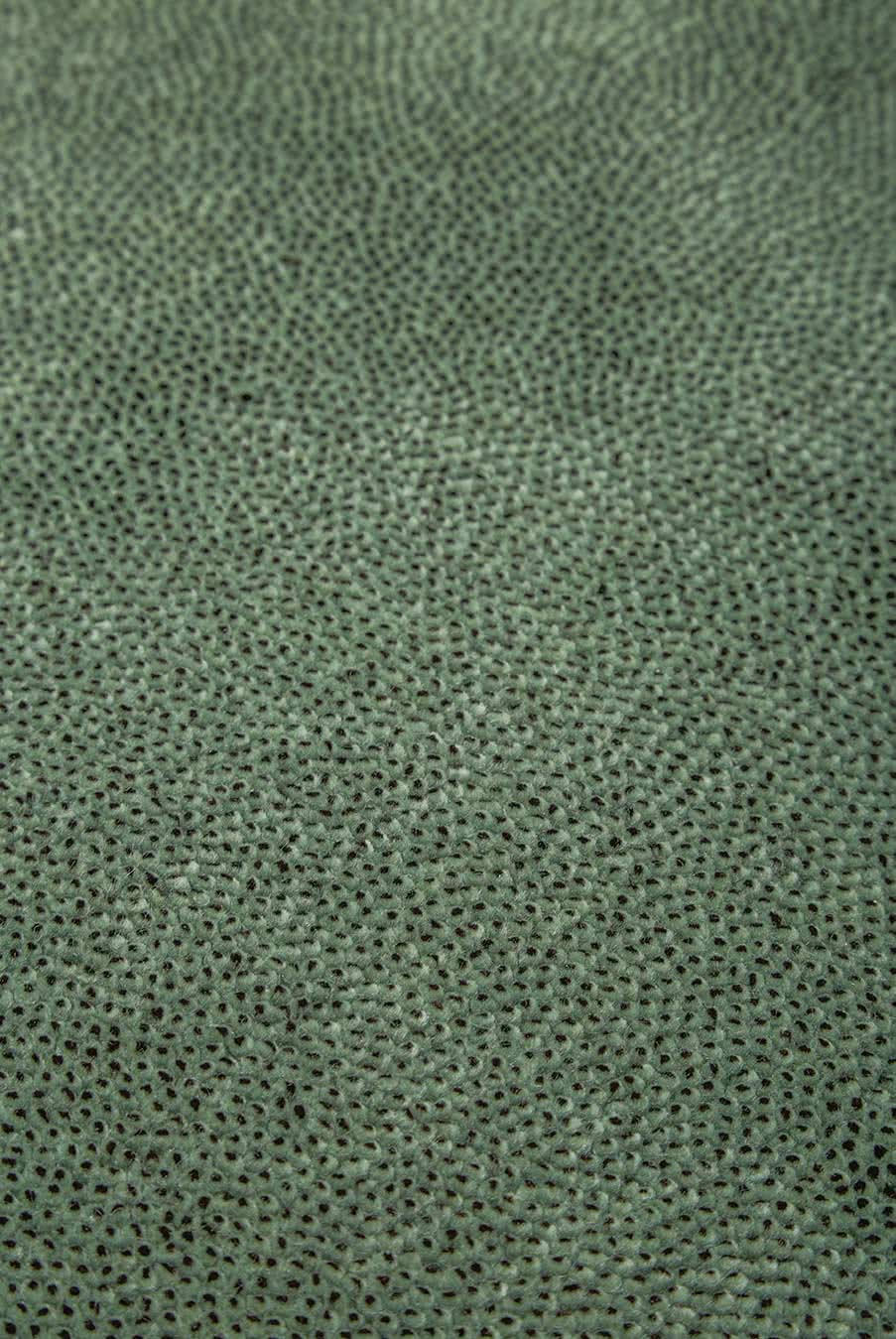 Close up view of textured Coral Cut Pile rug in green colour