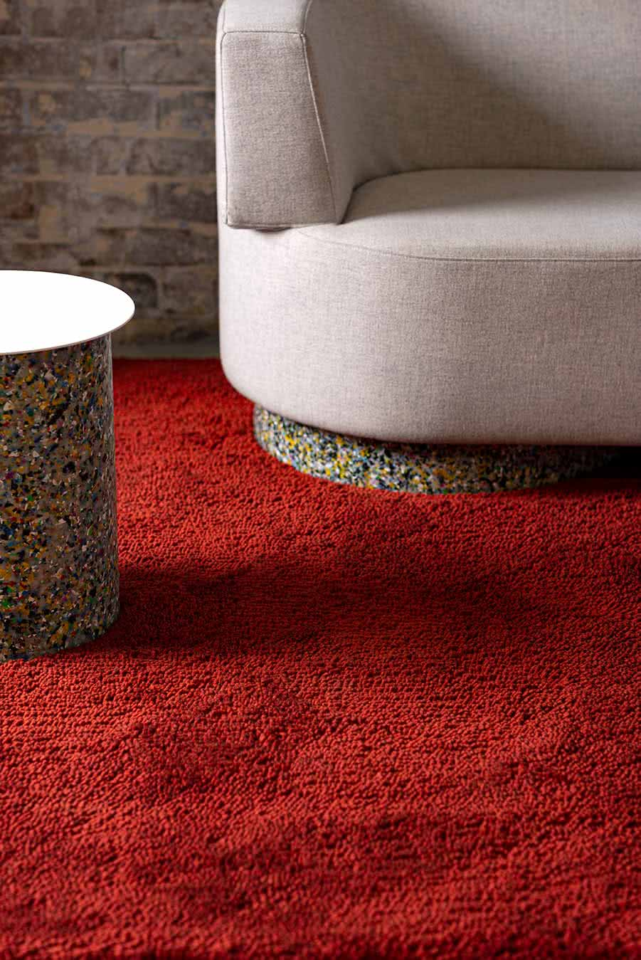 Living room view of textured Coral Shag rug in red colour