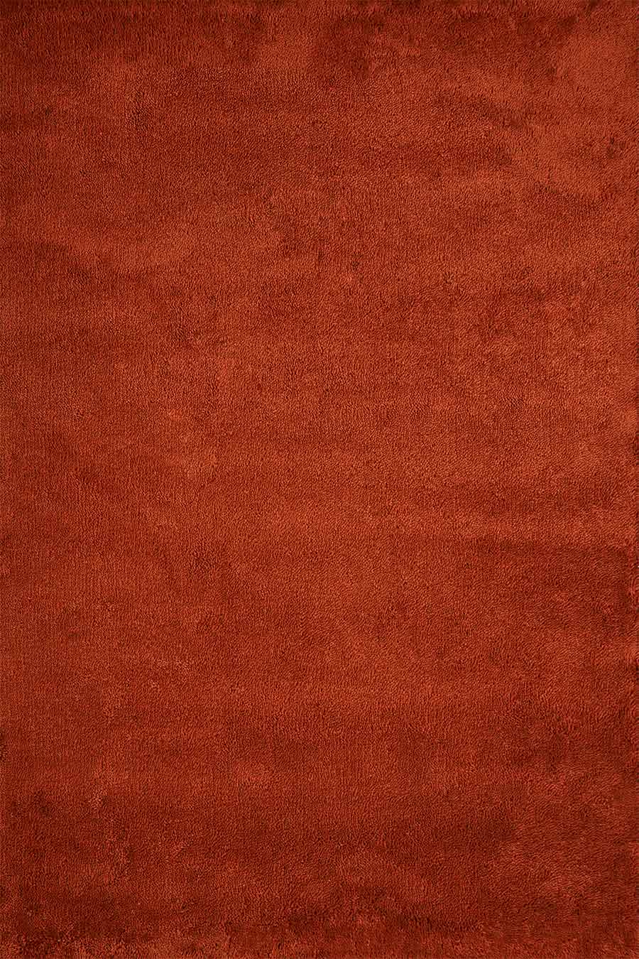 Overhead view of textured Coral Shag rug in red colour