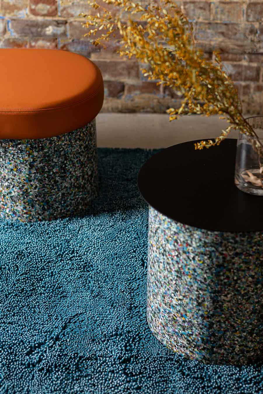 Styled close up view of textured Coral Shag rug in teal blue colour