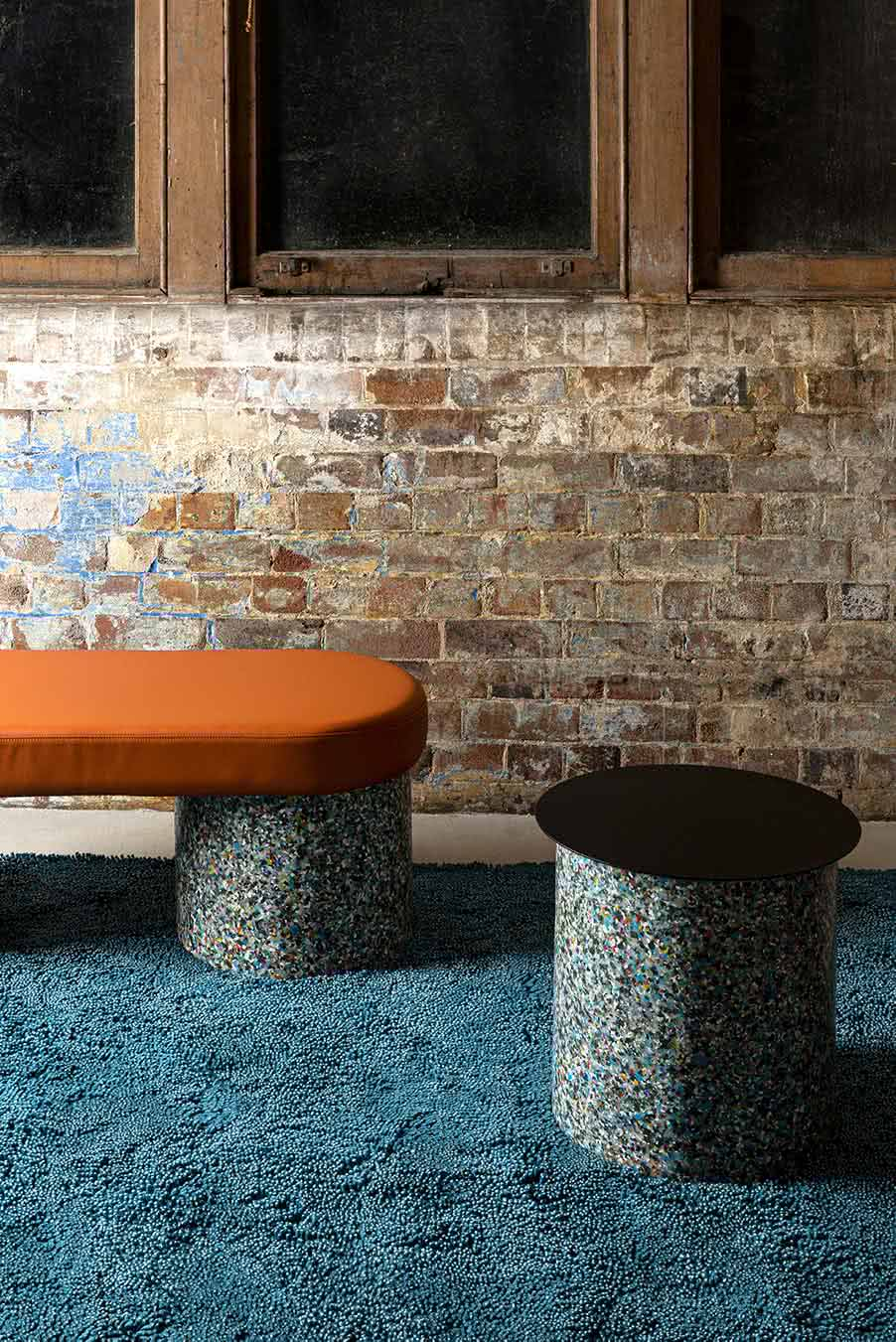 Styled view of textured Coral Shag rug in teal blue colour