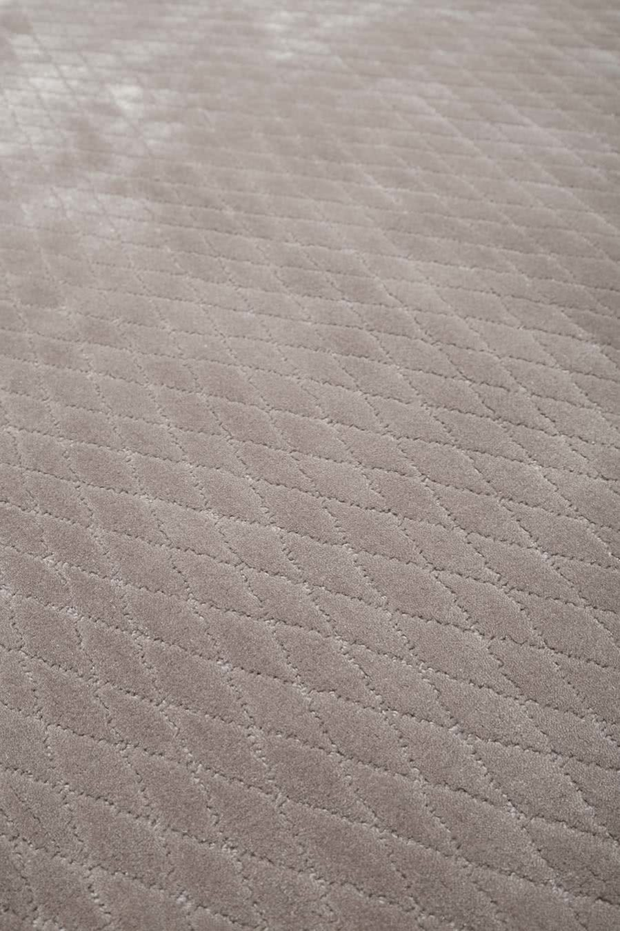 Close up view of textured Diamond Velour rug in light beige colour