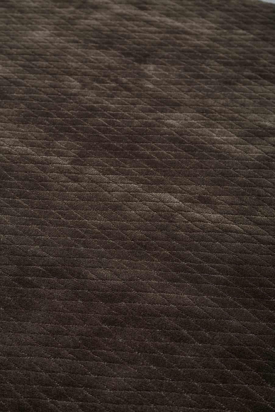 Close up view of textured Diamond Velour rug in dark brown colour