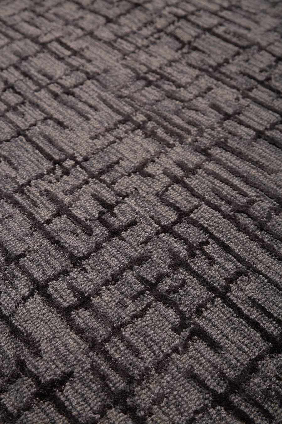 Close up view of textured Krypton rug in charcoal grey colour