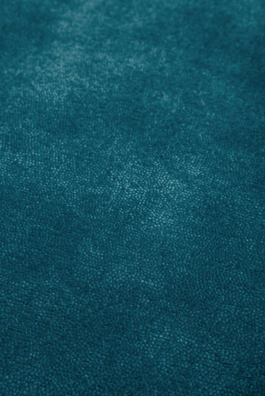 Close up view of textured Napoleon Cut Pile rug in teal colour