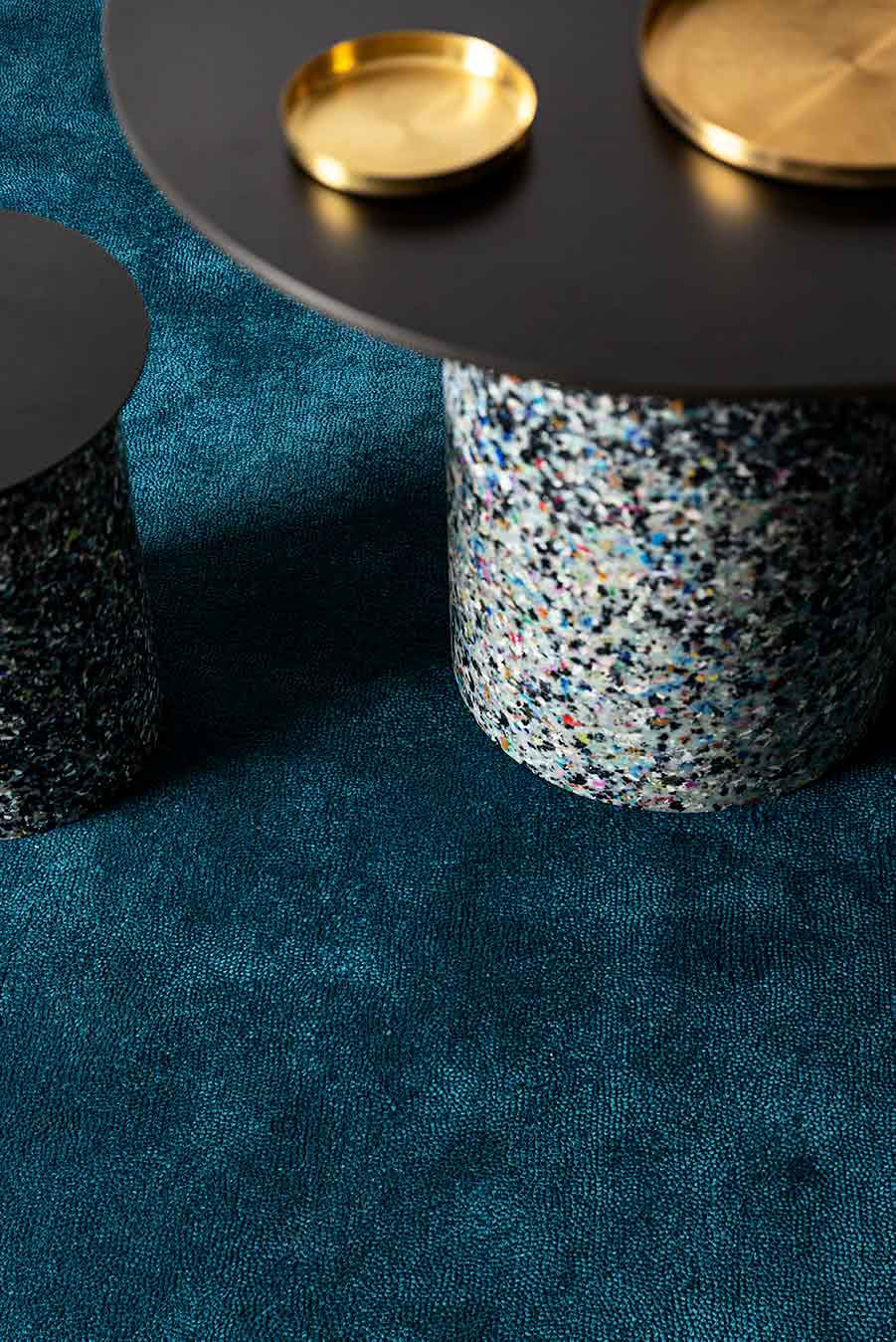 Close up dining room view of textured Napoleon Cut Pile rug in teal colour