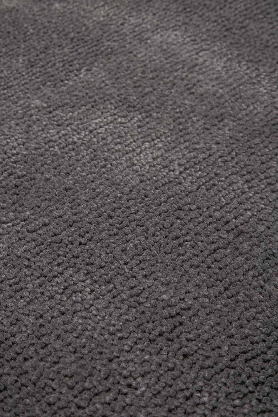 Close up view of textured Napoleon Jay Shag rug in grey colour