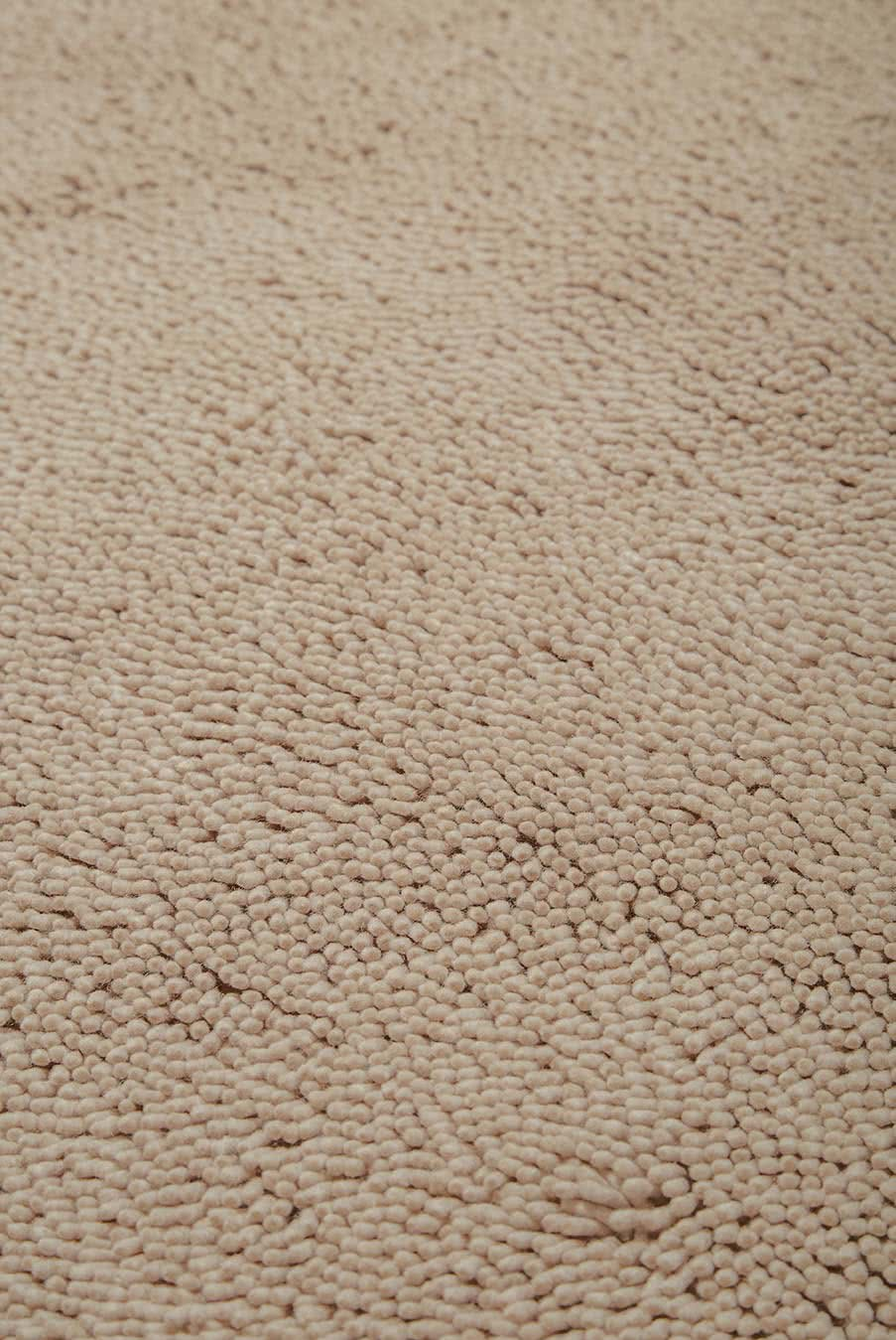 Close up view of textured Napoleon Shag rug in beige colour
