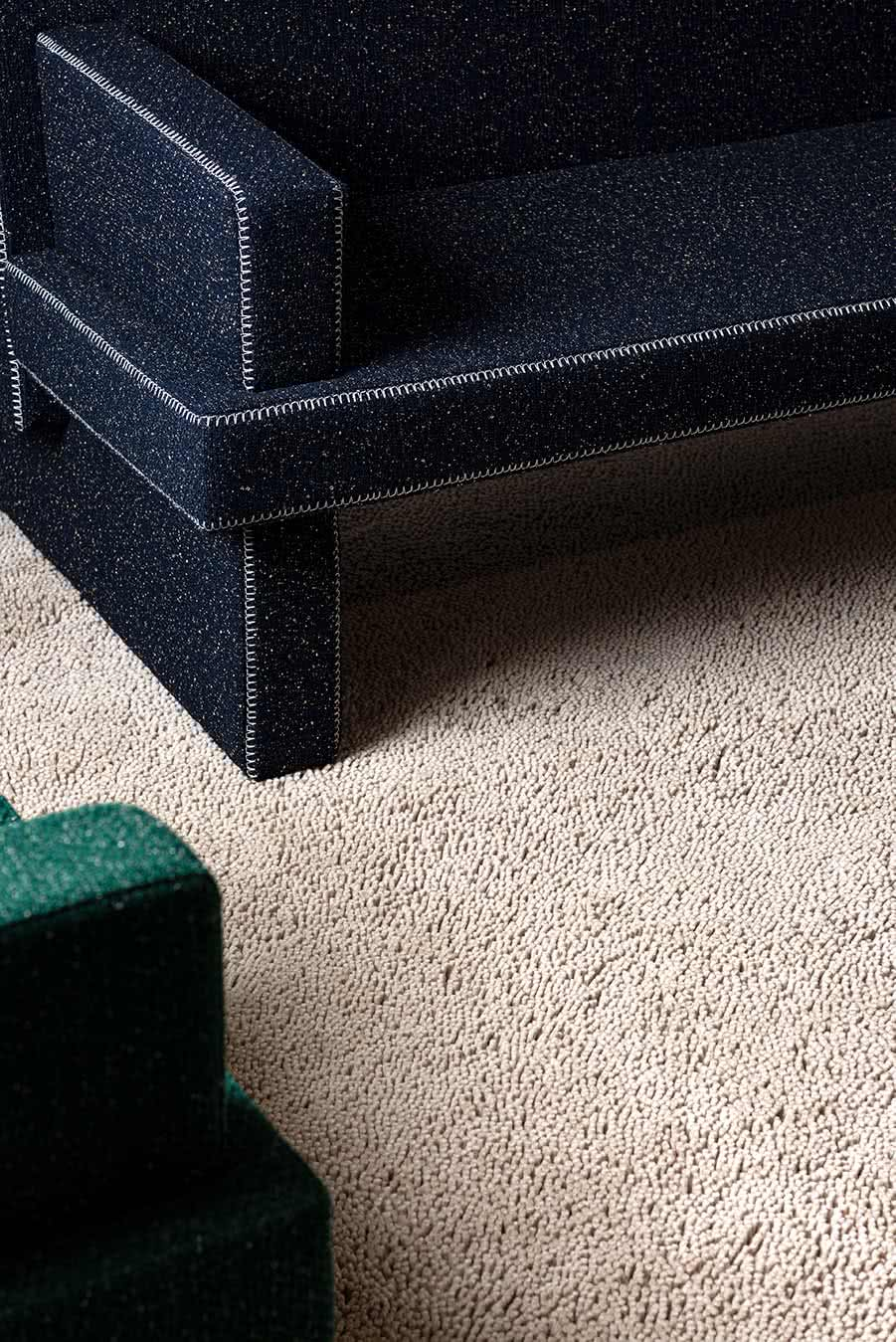 Close up living room view of textured Napoleon Shag rug in beige colour