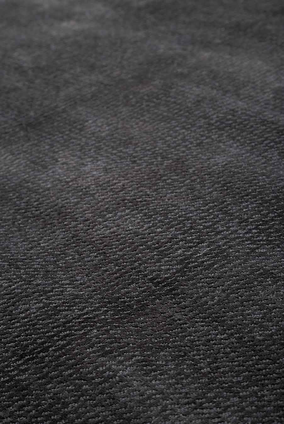 Close up view of textured Nickel rug in charcoal colour