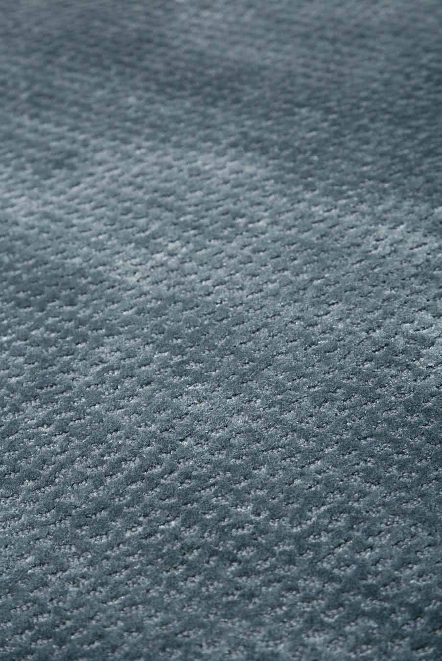 Close up view of textured Nickel rug in denim colour