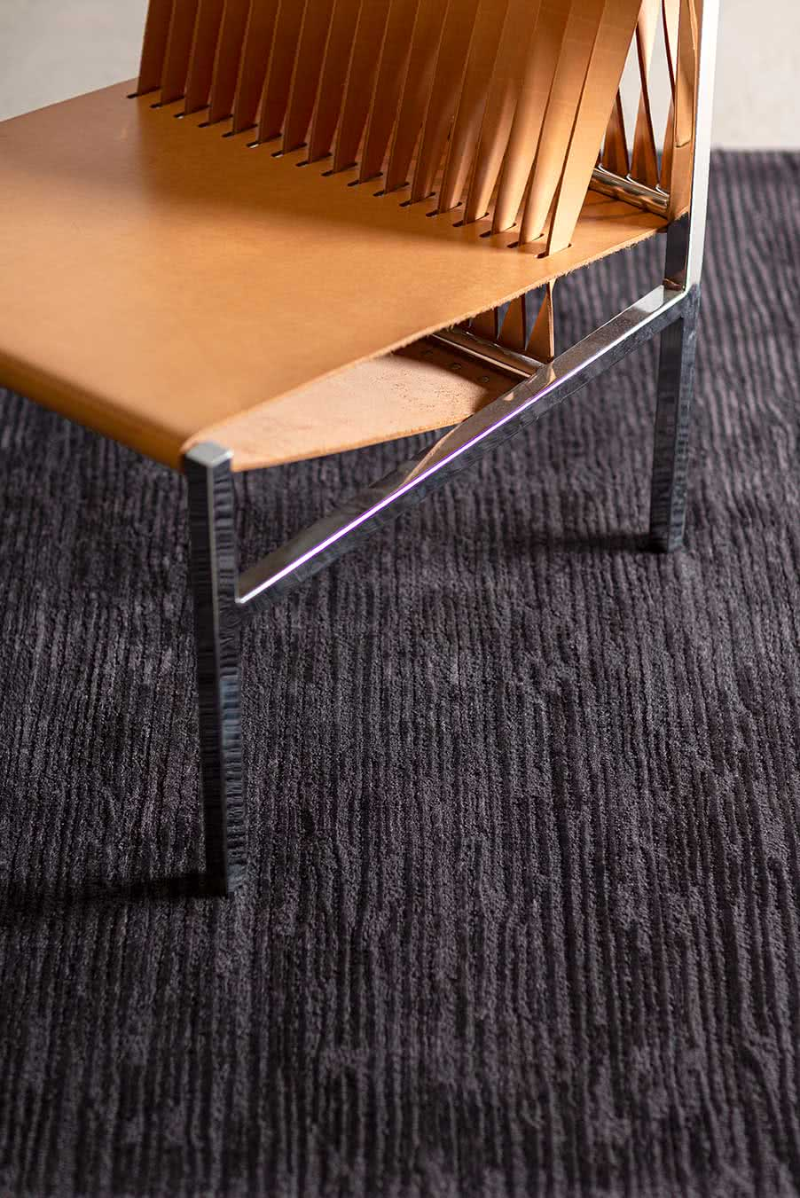 Close up view of textured Rhodium rug in charcoal colour