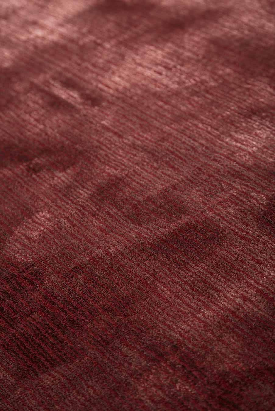 Close up view of Safari rug in wine mix colour