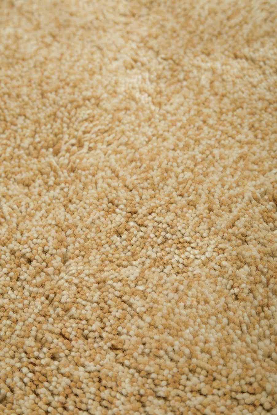 Close up view of textured Stipple Shag rug in beige colour