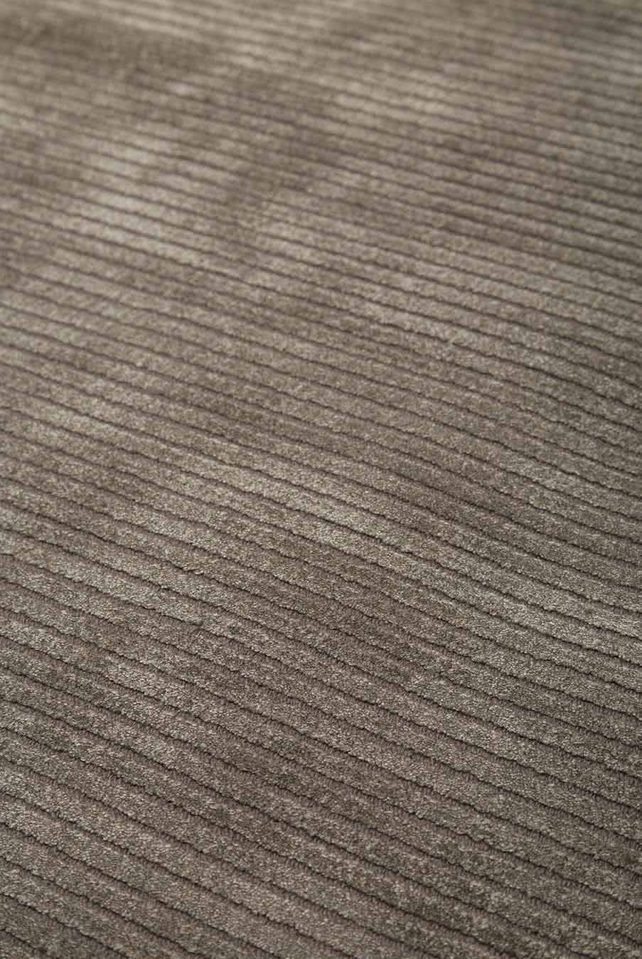 Close up view of textured Velour rug in dark beige colour
